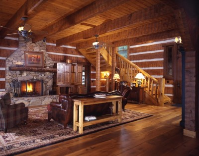 Great room log section with stone fireplace
