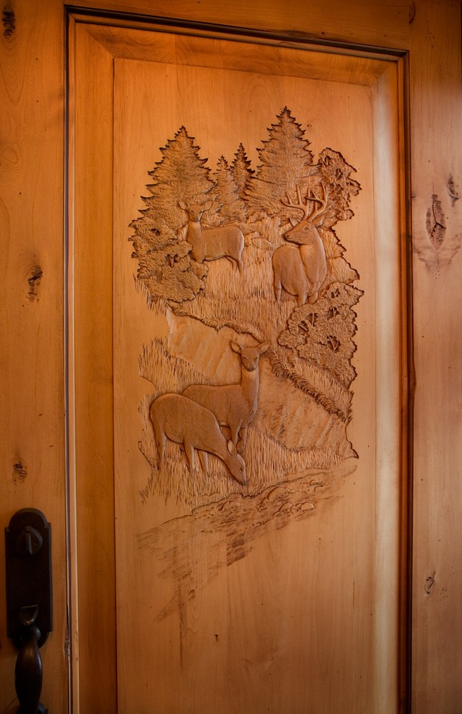hand carved entry door in tennessee home built by Mountain Construction