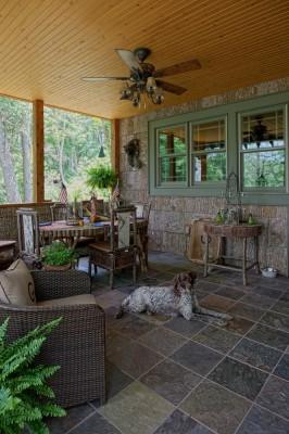 Poplar bark siding, twig railing and stone fireplace