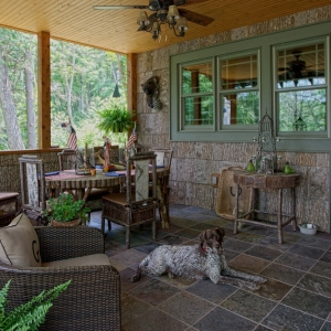 Poplar bark siding, twig railing and stone fireplace