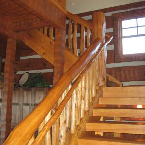 Stairway Log Timber Frame hybrid home in Bethel, NC