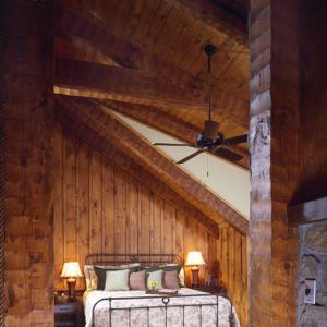 Bedroom in Timber Frame Log Hybrid Lodge Home