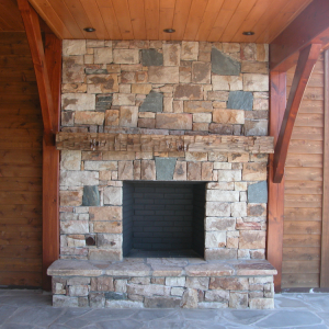 Timber Frame hybrid home with outdoor fireplace