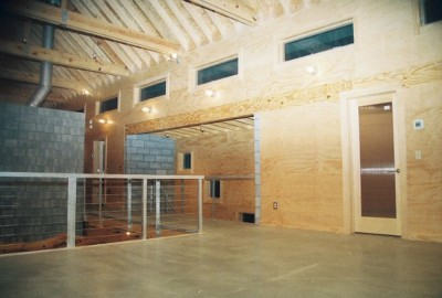 contemporary home with plywood walls and concrete floor