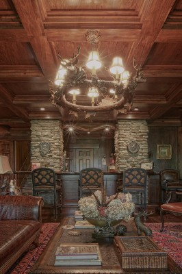 coffered ceilings with wood and stone in lower level