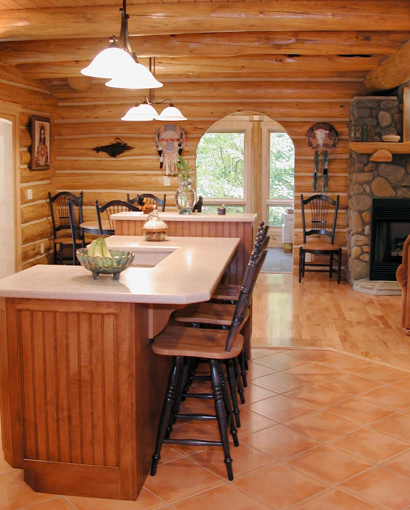Custom Round Log home built by Mountain Construction near Jefferson, NC