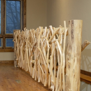 hand-crafted twig railing adds rustic flair