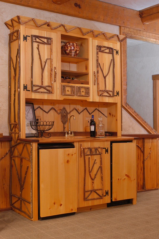 handcrafted wet bar with twig accents built by Mountain Construction near Banner Elk, NC
