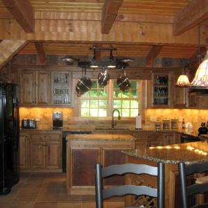 Custom log home in NC mountains designed to blend into the woods