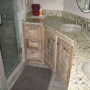 handcrafted cabinets of maple and birch bark create unique accent for bathrooms