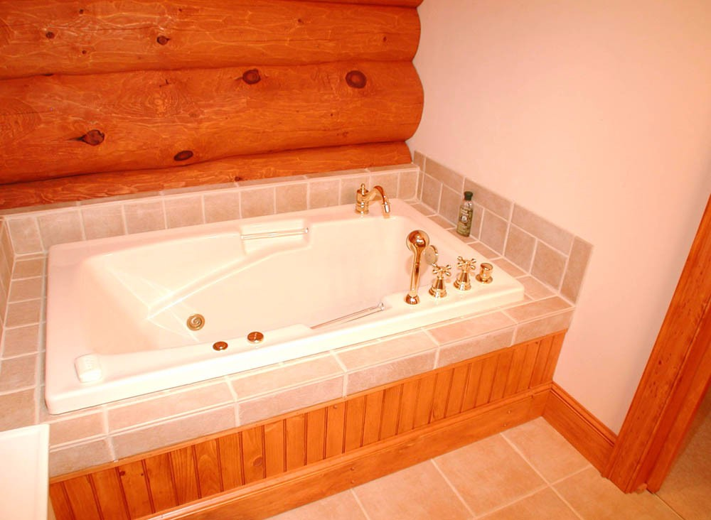 tile bath tub in a log home