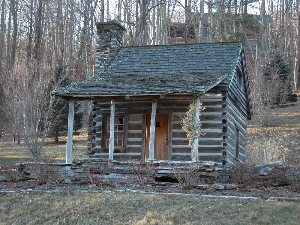 antique small log cabin house