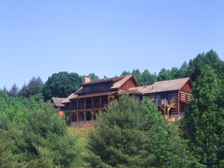 Log timber frame estate home