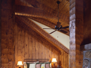 Bedroom in Timber Frame Log Hybrid Lodge Home