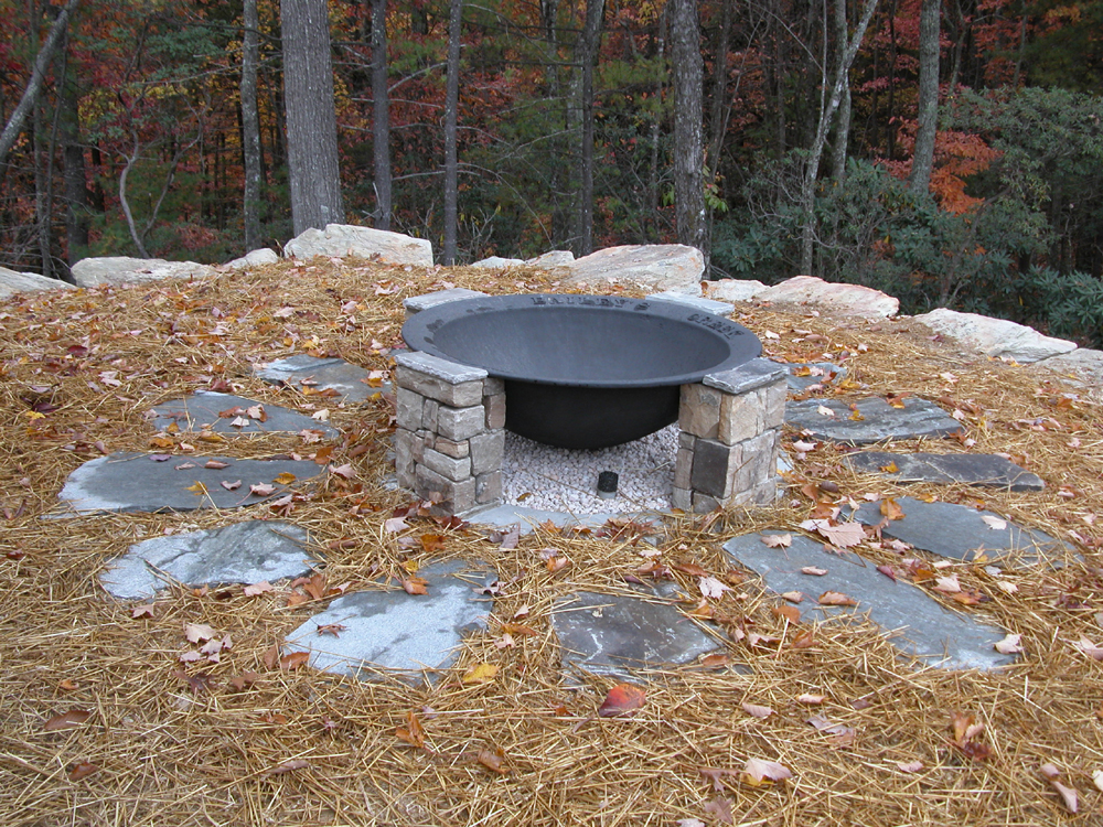 Handcrafted fire pit at family getaway