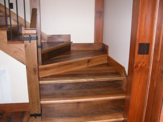 Elegant staircase made from reclaimed lumber
