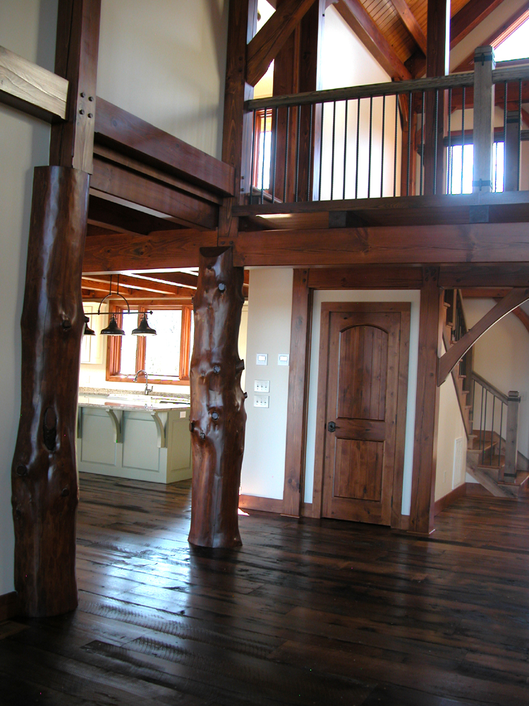Timber Frame home with reclaimed flooring