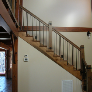 Timber Frame home with stairs of reclaimed wood