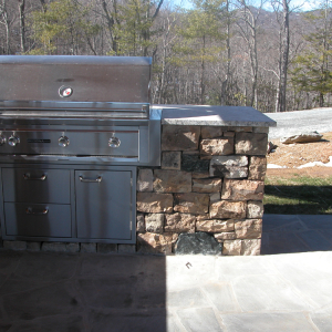 Outdoor Kitchen with stone accents